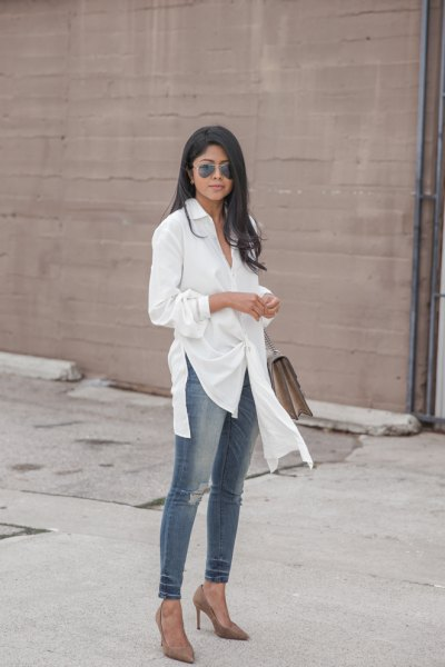 white tunic shirt with gray skinny jeans and heels