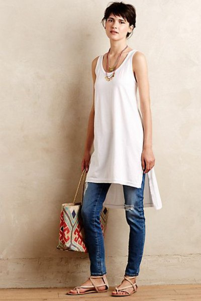 white tunic tank top with blue jeans with a slim fit