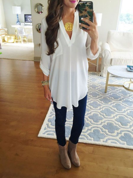 white V-neck top and gray suede boots