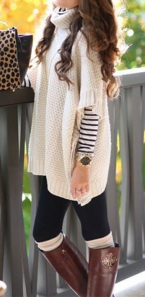 Chunky poncho sweater with white turtleneck and sleeves over the striped long-sleeved T-shirt
