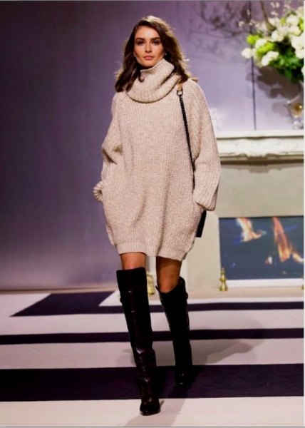 white turtleneck dress with black, thigh-high leather boots