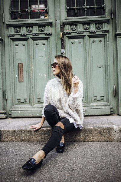 white turtleneck with turtleneck and black leather loafers