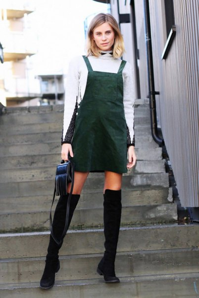 white turtleneck with over-the-knee boots