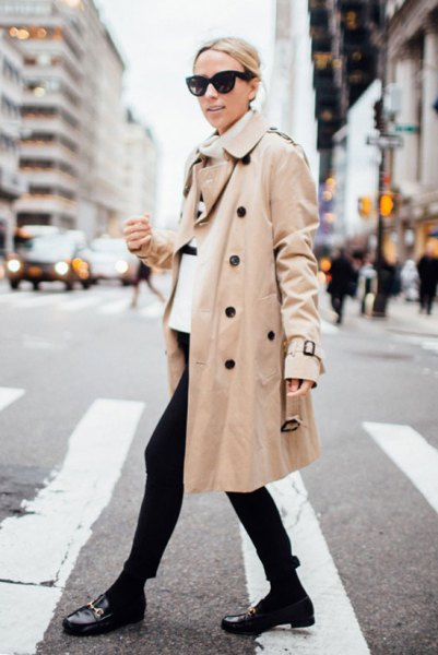 white turtleneck with a beige trench coat