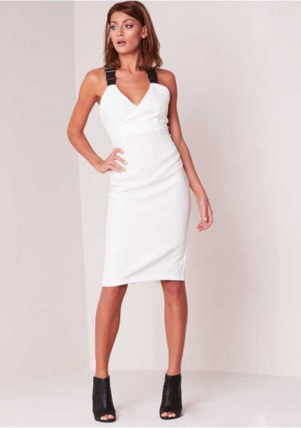 white bodycon dress with V-neckline and black straps