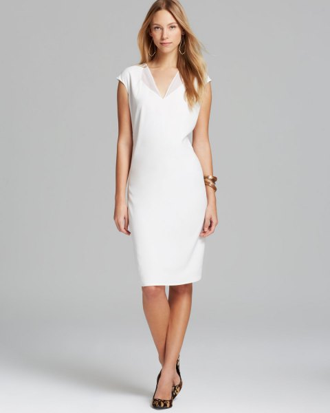 white midi dress with wing neckline and V-neck