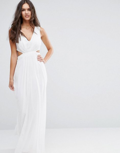 white, floor-length, flowing dress made of chiffon with a V-neck