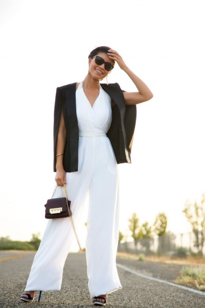 white jumpsuit with V-neck and flare with black blazer