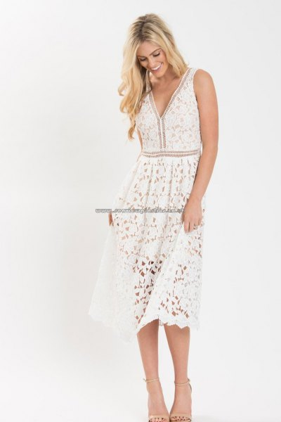 white midi lace dress with V-neckline and flared tank and open toe heels