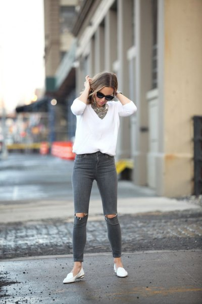 white knitted V-neck sweater, gray, ripped jeans