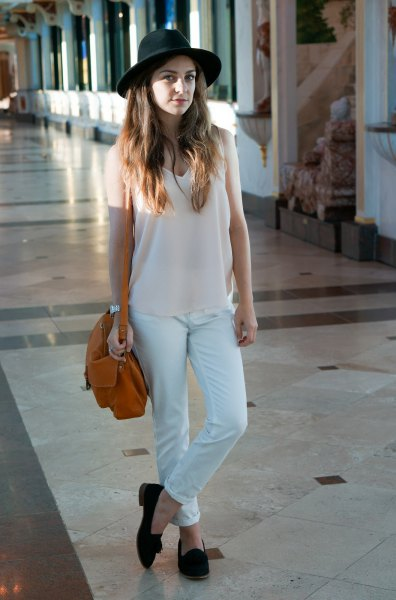 white long tank top with V-neckline, matching chinos and felt hat