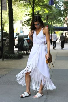 white wrap dress with maxi fringes and V-neck