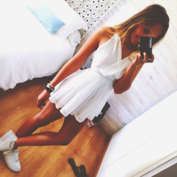 white, pleated and flared mini dress with V-neck