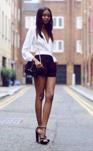white blouse with puff sleeves and V-neck and black mini-shorts