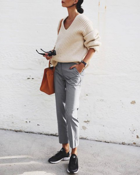 white ribbed sweater with V-neckline and gray, short-cut chinos