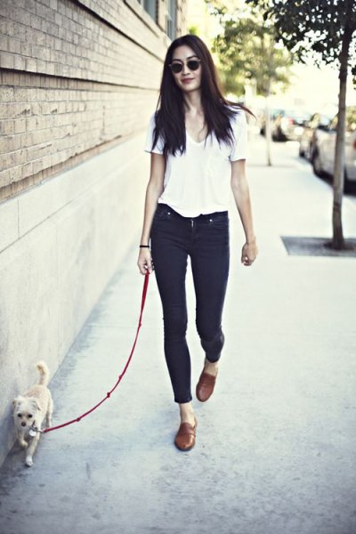 white V-neck t-shirt with blue jeans with cuffs and light brown leather loafers