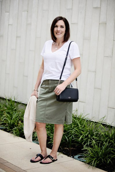 white V-neck t-shirt and gray knee-length straight skirt