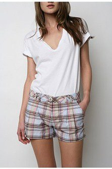 white V-neck t-shirt and light blue checkered mini-shorts