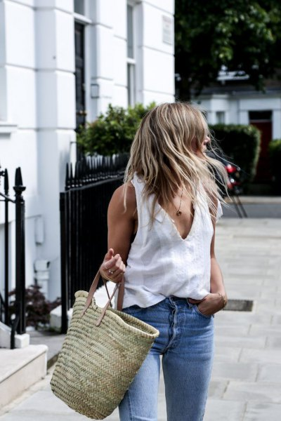 white tank top with V-neck, blue jeans and straw sack