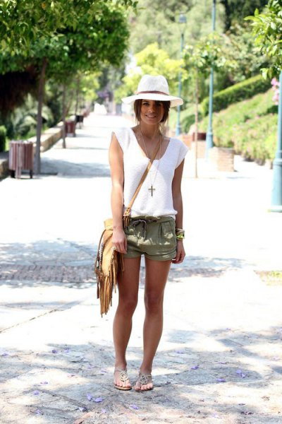white tank top with V-neck, green shorts and fringed pocket