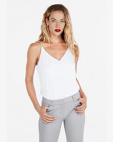 white tank top with V-neck and gray slim fit jeans