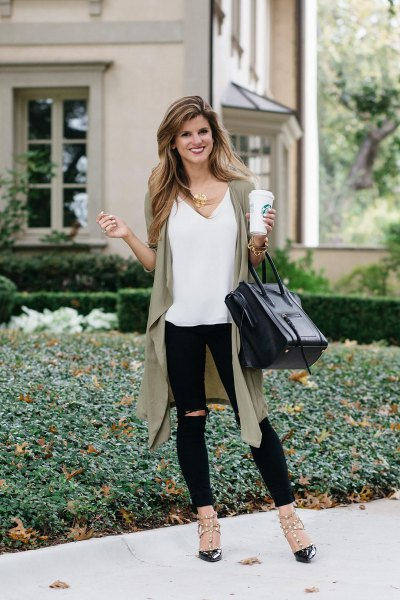 white V-neck tank top, olive-green longline vest and ripped jeans