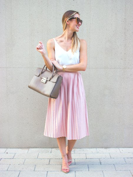 white V-neck tank top and pink silk pleated midi skirt