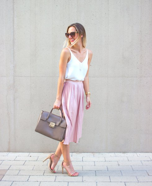 white vest top with V-neck and pink midi pleated skirt
