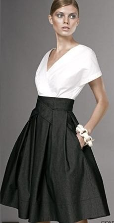 white wrap blouse with V-neckline and black, high-waisted midi skirt with pockets