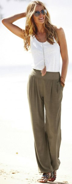 white vest top with green beach pants with wide legs