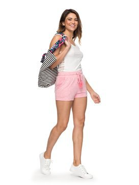 white vest top with light pink mini-shorts