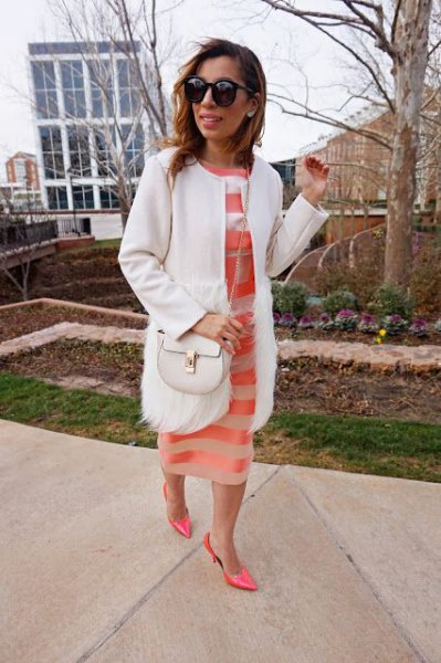 white walker coat with blushing pink semi-transparent midi dress