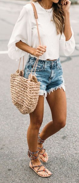 white wide blouse with half sleeves and blue denim shorts in distressed look