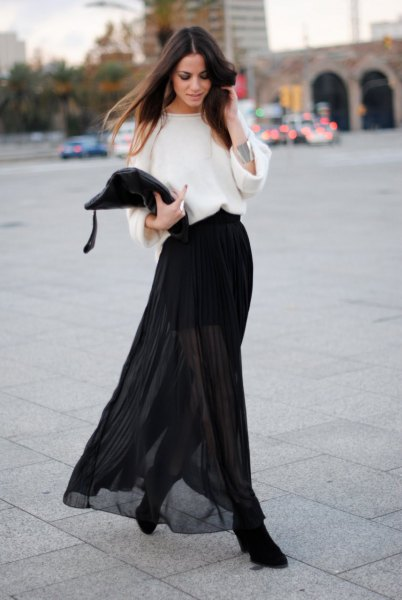 white wide-sleeved sweater black transparent skirt