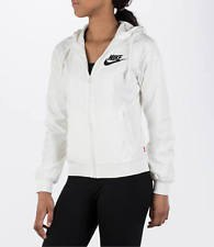 white windbreaker with black running shorts