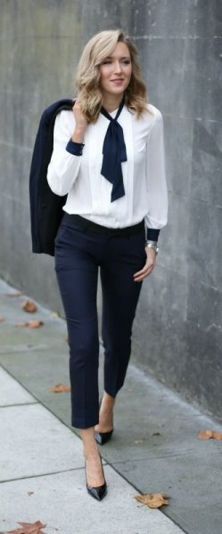 White with a black necktie and dark jeans