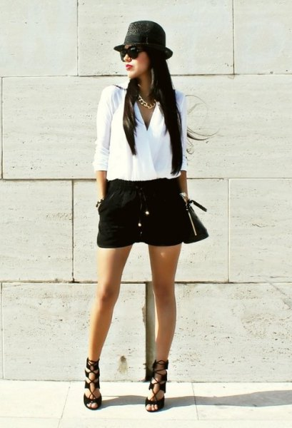 white wrap blouse with black mini short hat and flat hat