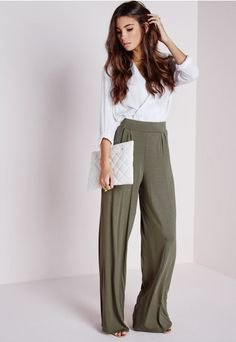white wrap blouse with gray pants with a high waist and wide legs