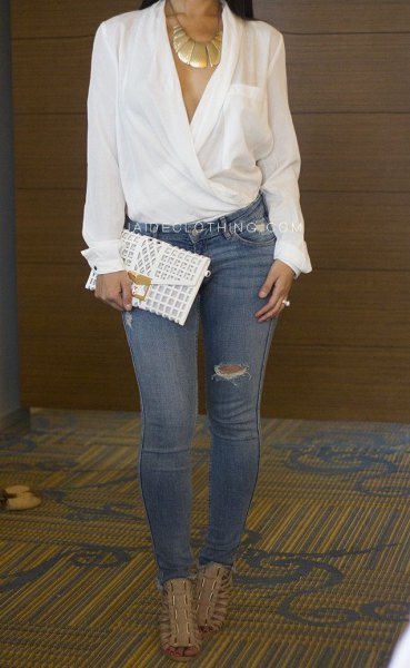 elegant white wrap blouse with blue ripped skinny jeans