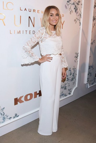 Wide leg trousers and white long-sleeved lace blouse