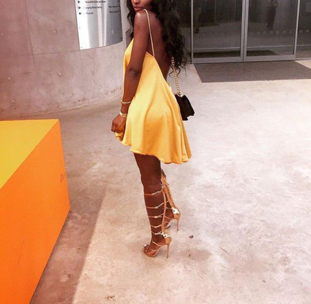 yellow backless skater dress with matching lace-up shoes