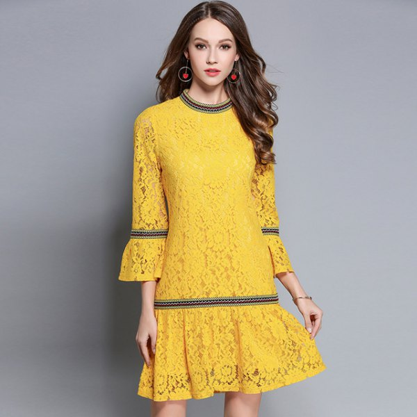 yellow flared dress with bell sleeves