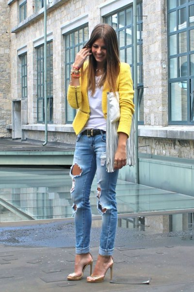 yellow blazer with blue ripped boyfriend jeans with gold evening shoes