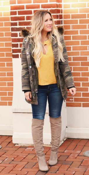 yellow blouse with camouflage jacket and overknee boots