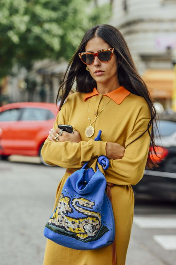 yellow blue outfit blue bag