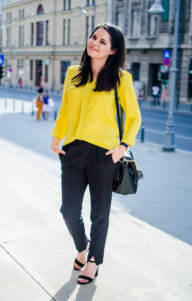 yellow shirt with buttons, black chinos and sandals
