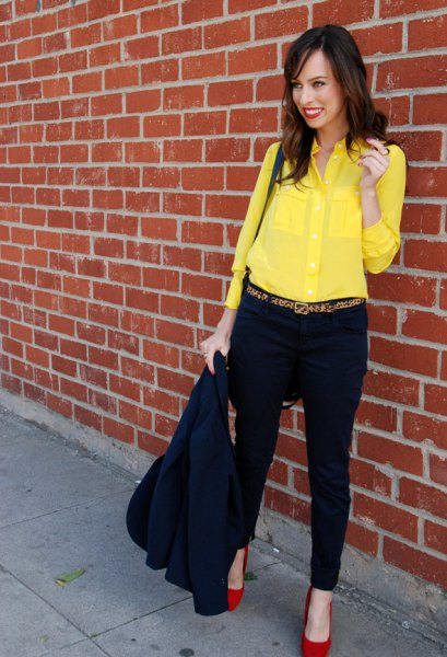yellow shirt with buttons, black chinos and red heels