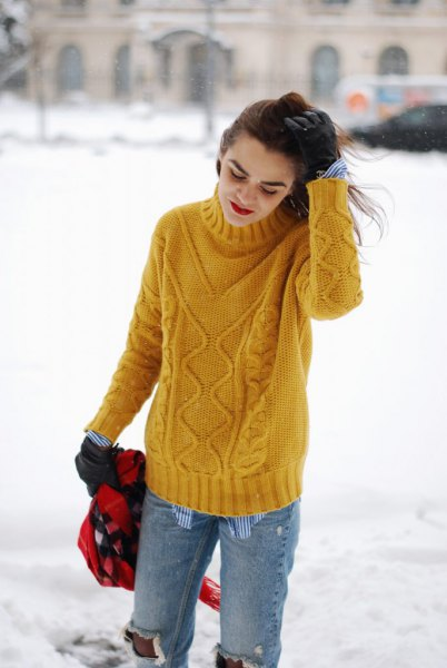 yellow cable knit sweater with torn boyfriend jeans