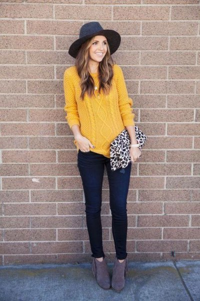 yellow knitted sweater with black felt hat