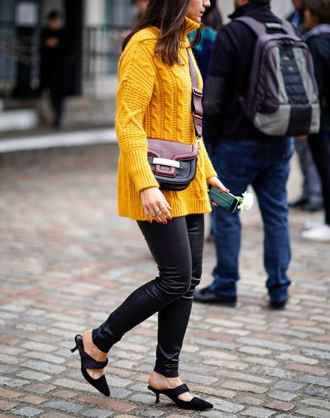 yellow cable knit sweater with black thin leather pants